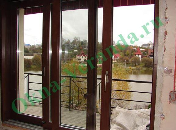 Okna veranda - двери деревянные.